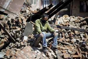 a-man-sits-on-rubble-after-the-nepal-earthquake-data